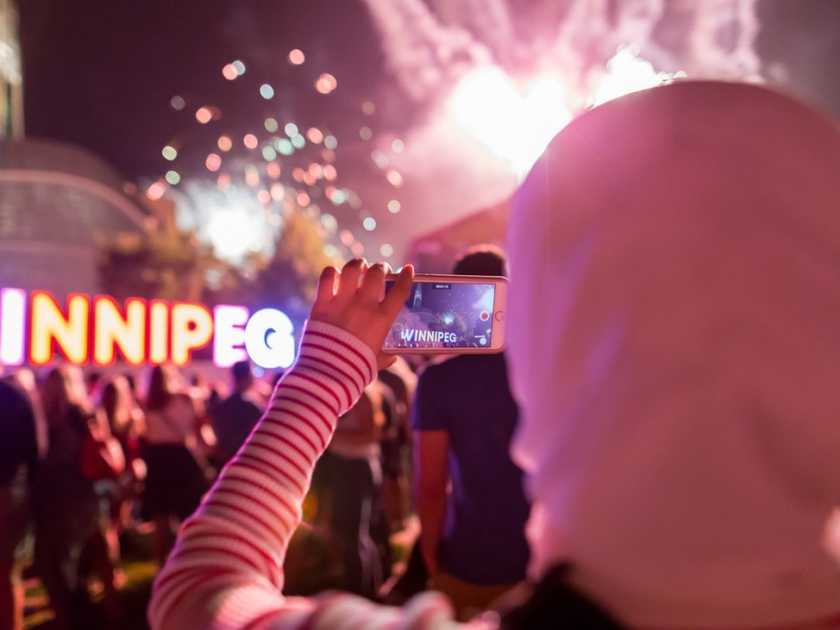 Virtual Canada Day in Winnipeg will be even better than the real thing - While you won't find crowds like this this year, you can still experience Canada Day on your phone like this person on July 1 (photo by Mike Peters)