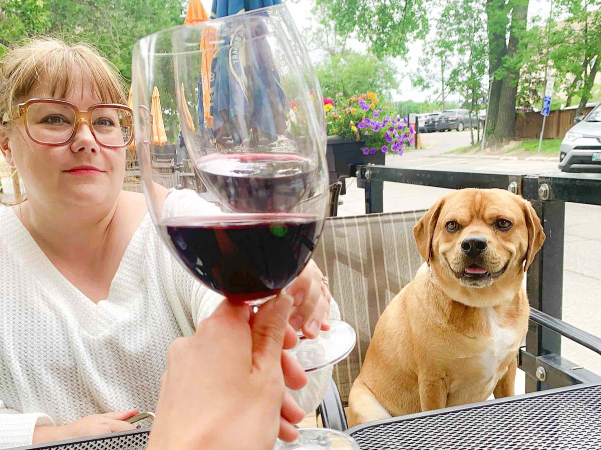 ​Raise the woof with your pooch in Winnipeg - Cheers to bringing your pal along to the Corrientes patio (photo: Rebecca Madziak)