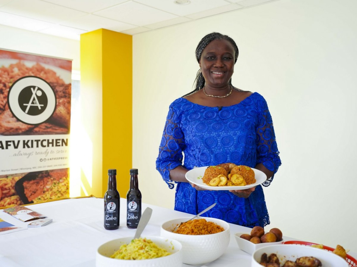 AFV Kitchen delivers the flavours of West Africa across Winnipeg - Folasade Akin-Akinbulumo showcases AFV Kitchen's most popular dish: jollof rice (photo: Maddy Reico)