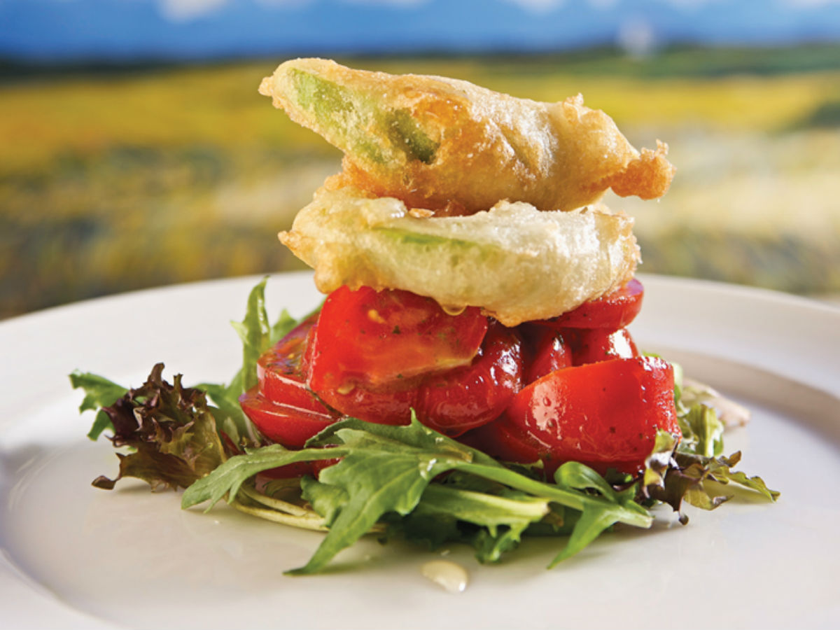 Fusion Grill: An epiphany in eating - Crispy Zucchini a-top a bed of ripened tomatoes and greens