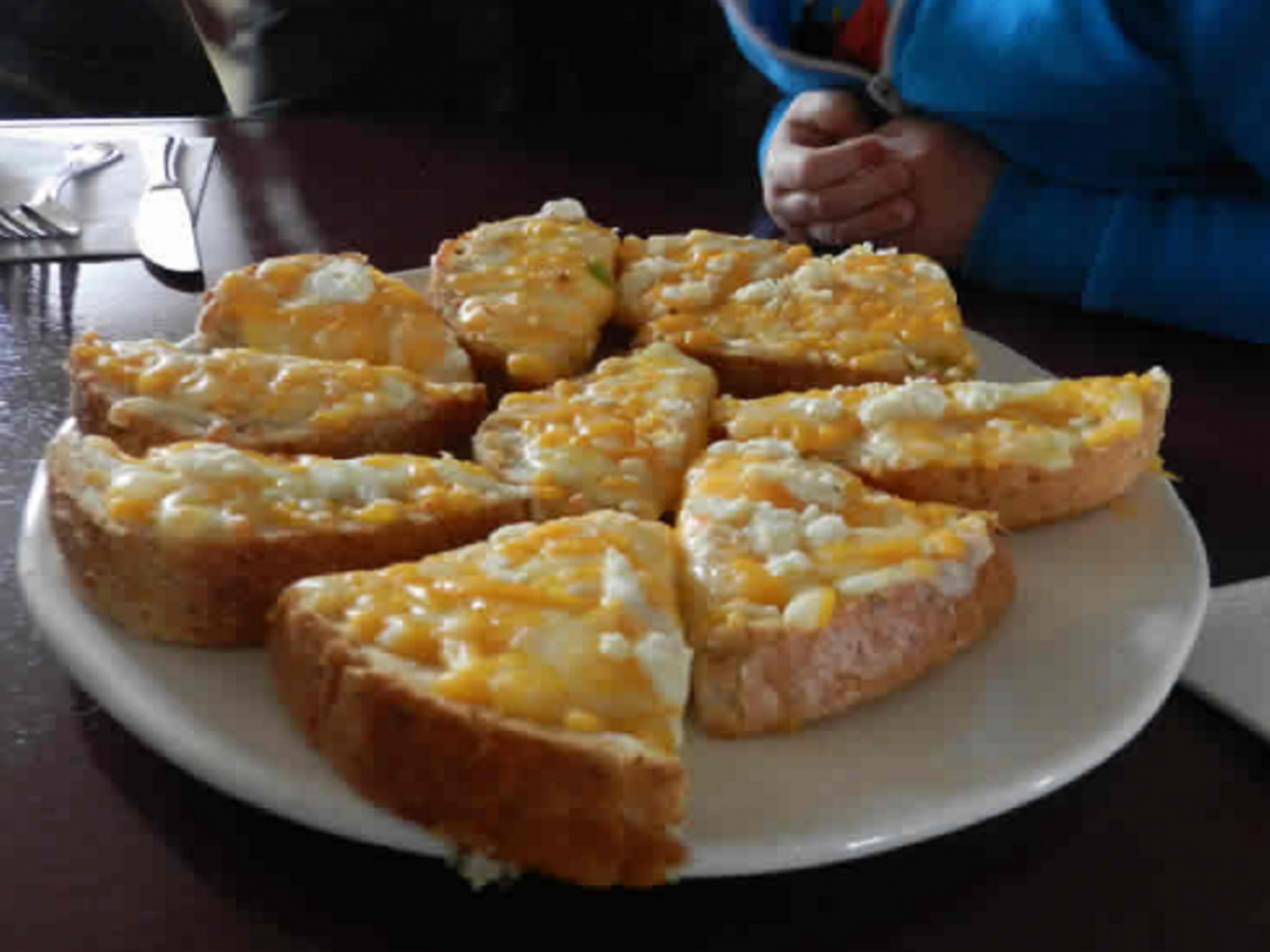 Yellow Dog Tavern: Homestyle Comfort Food - G-toast, slapped thick with cheddar!
