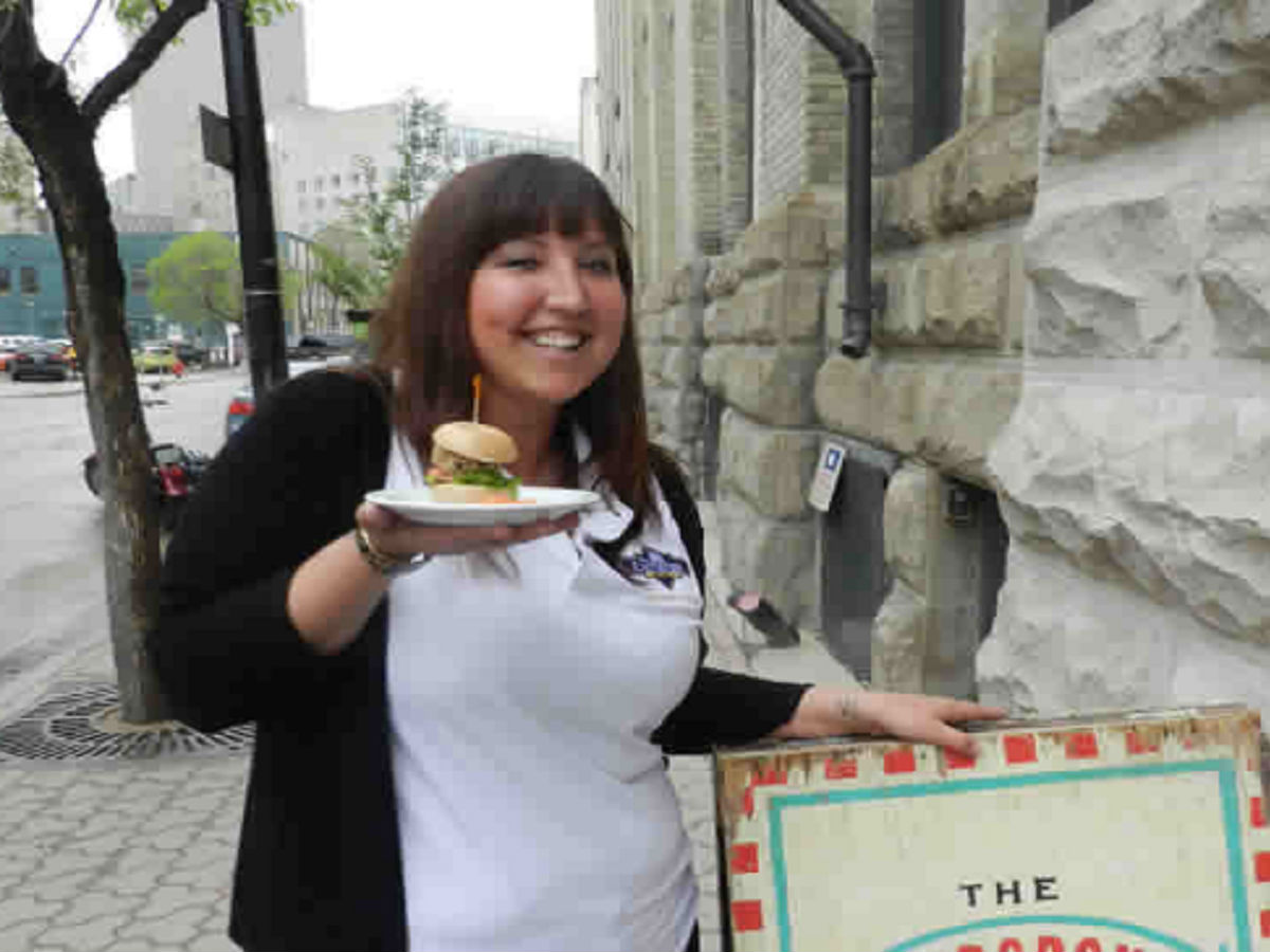 Devour the District: Winnipeg's eating adventure - This happens when you know you've got this golden sandwich awaiting your T-buds.