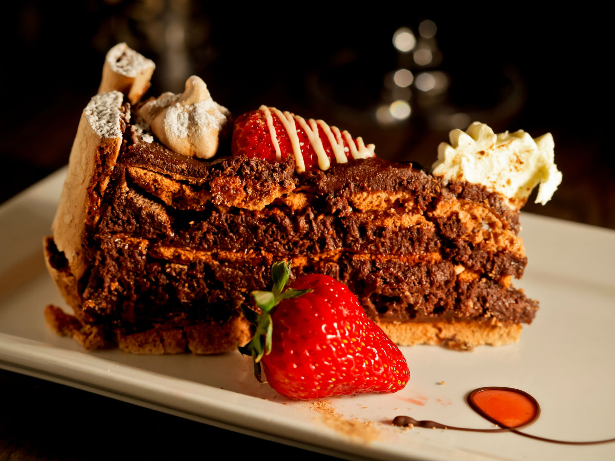 Promenade Café & Wine: Traditional French with a Twist - Chocolate brownie nut cake, with almond butter cream and strawberries