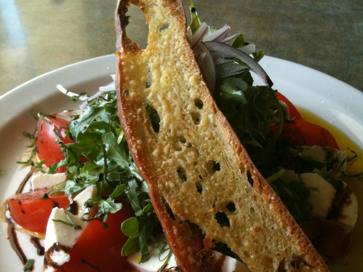 Bonfire Bistro: Pizza za za zing - Mouth watering oils and vinegars top this tomato salad as a succinct, refreshing lunch.