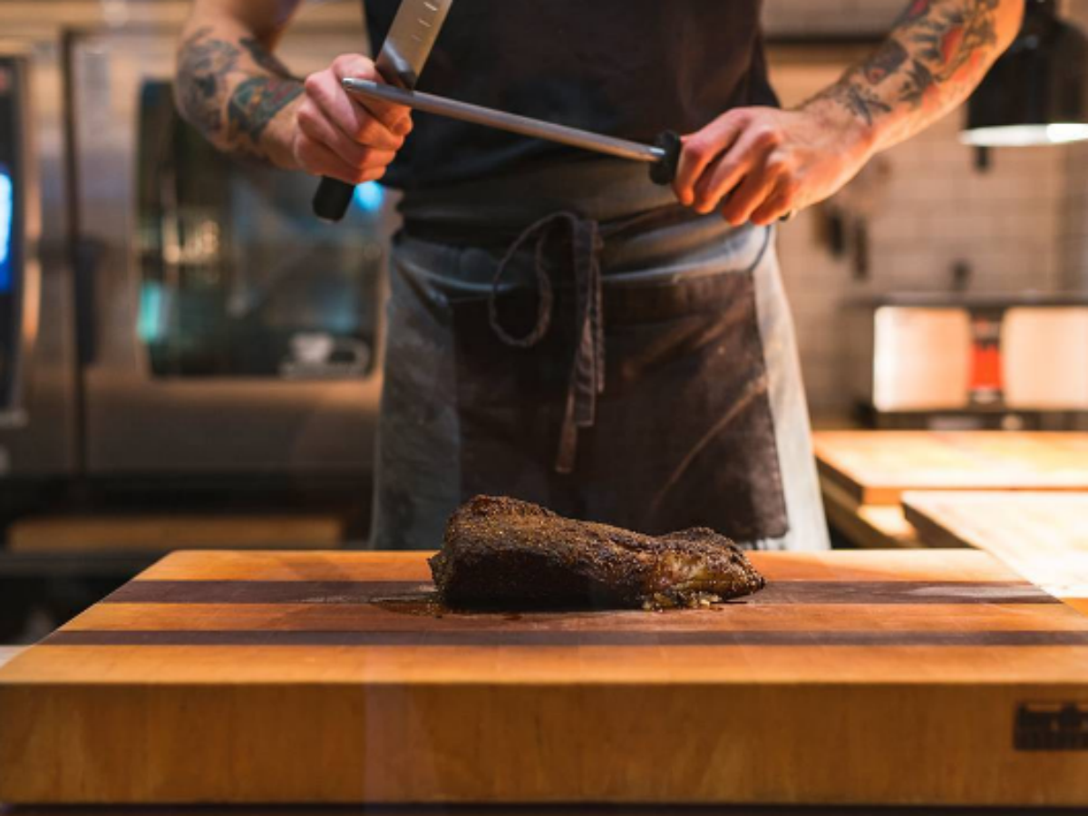 Meet Winnipeg's Newest Meat Kings - Sous Chef prepares to slice and dice this beautifully charred pork loin
