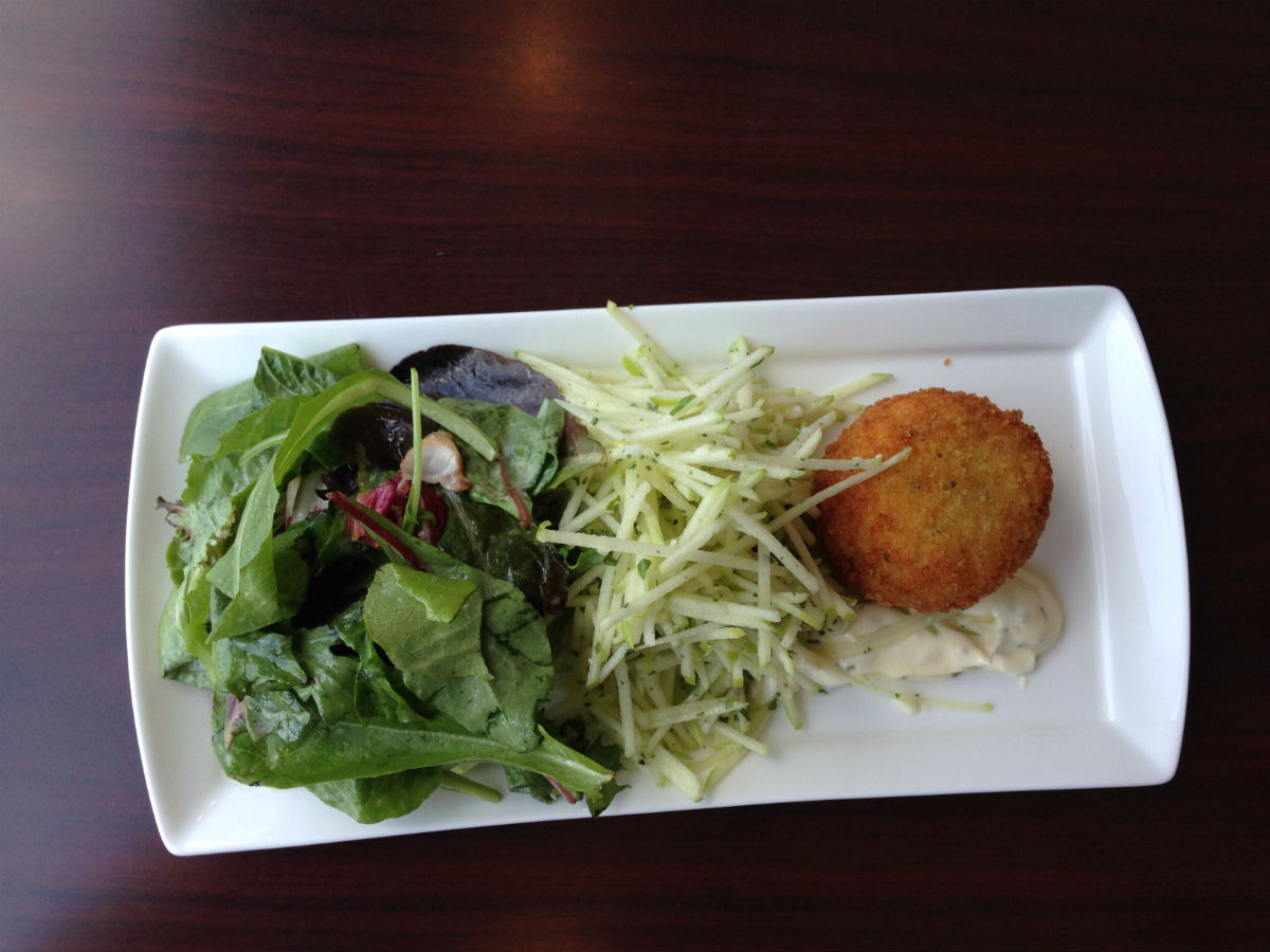 New & Notable: One of Vancouver's finest moves to Charleswood - a delicate spinach salad beside a perfected mozza ball.