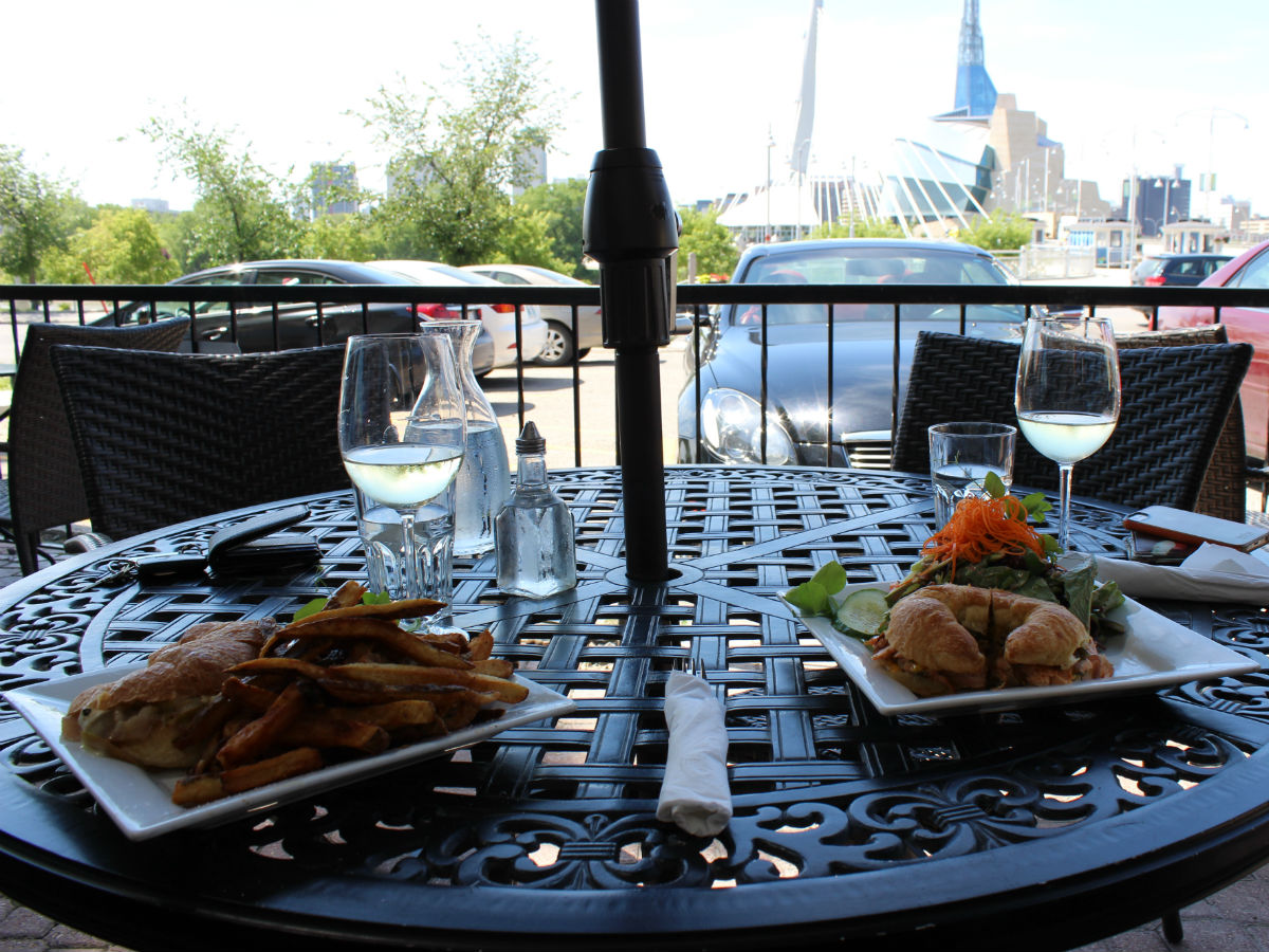 Promenade Café and Wine's patio is always prime time in summertime - An enjoyment of the simple pleasures in life-only a few steps away from our iconic landmark: the Esplanade Riel