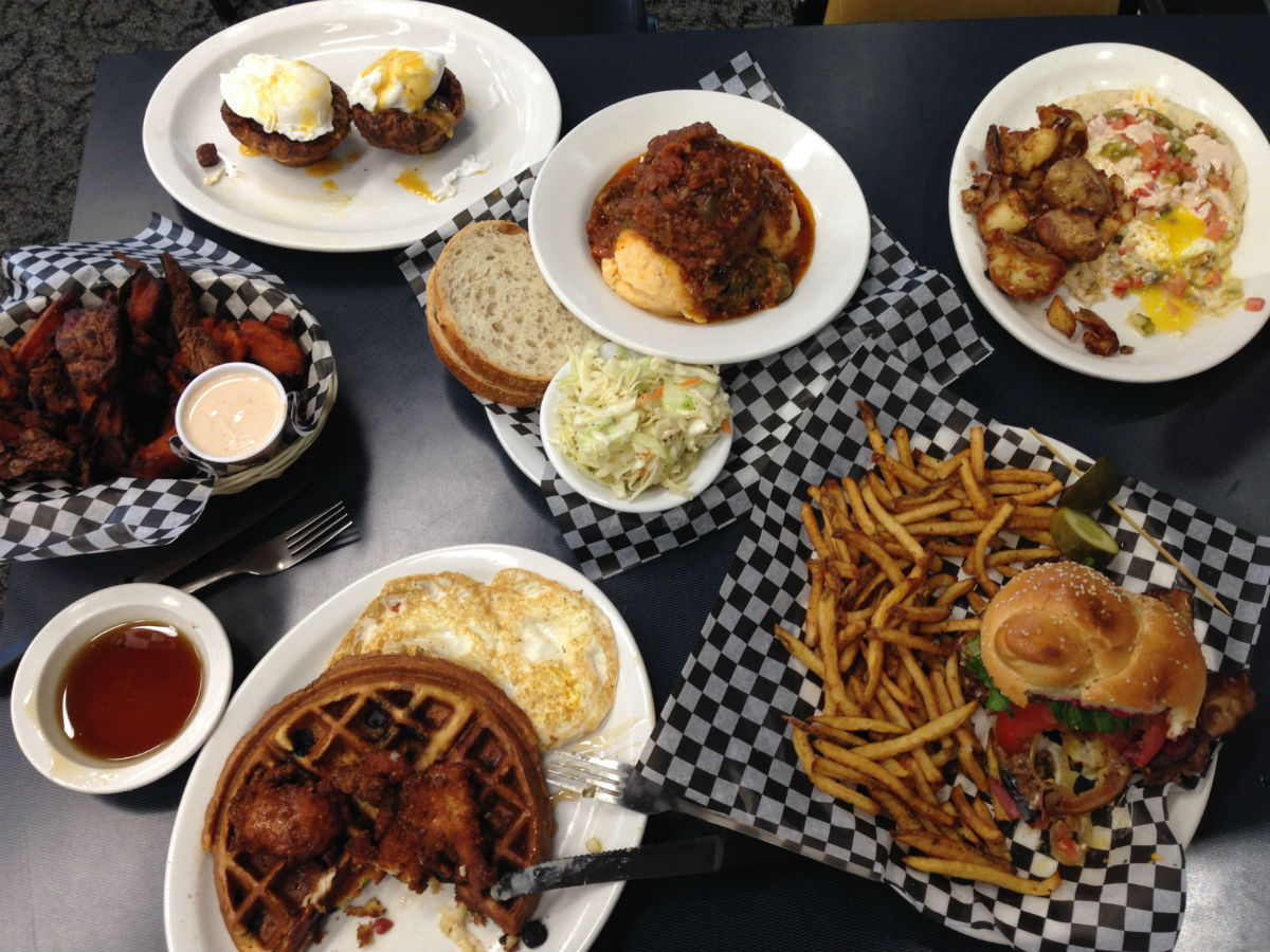 Oscar's Deli is brimming with history and great comfort food - Fried chicken and waffles, fresh bubbling hot chilli, charred yam fries, and Oscar's famous Dirty Burger with extra bacon of course.