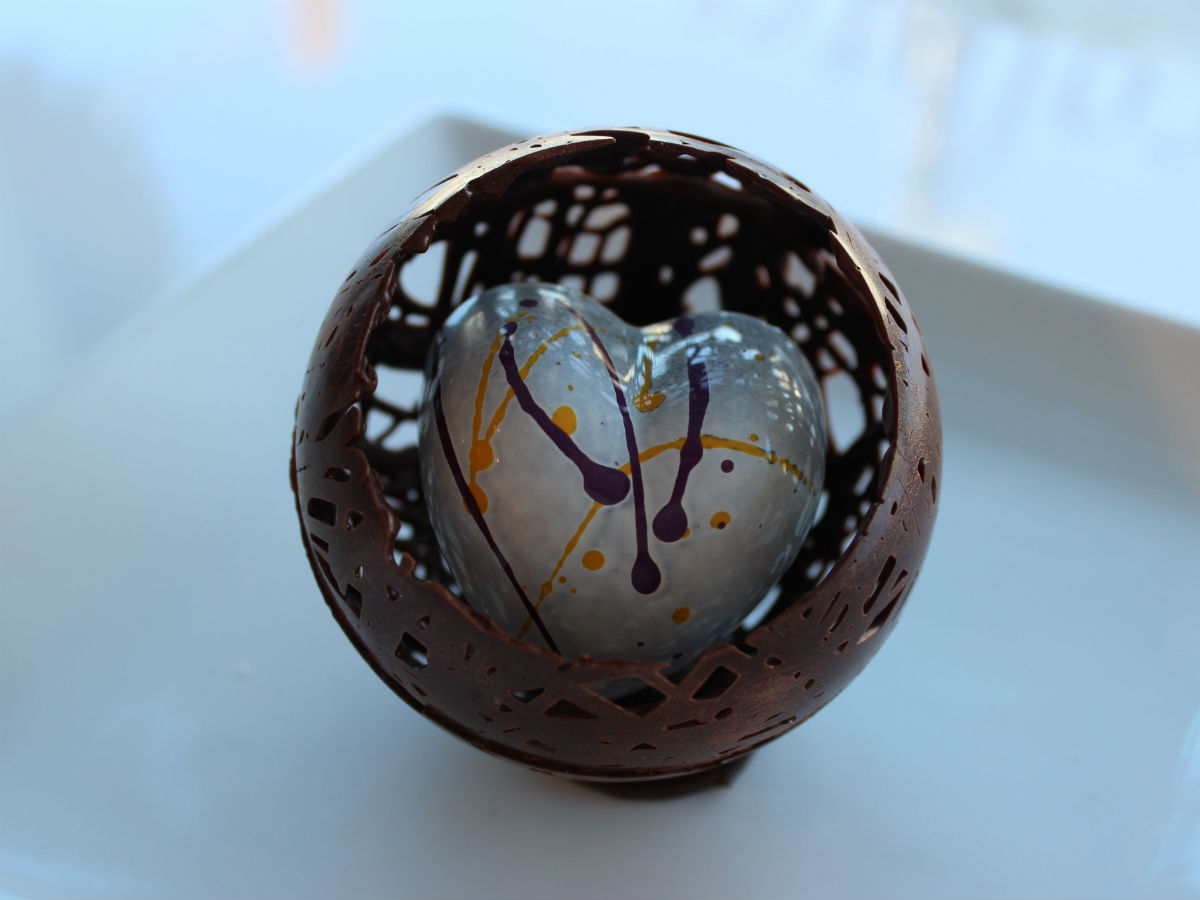 How to win hearts on Valentine's Day (and learn everything about cacao) at Chocolatier Constance Popp - A passion fruit jel and vanilla bean marshmallow filled heart within a chocolate sphere at Chocolatier Constance Popp (PCG)