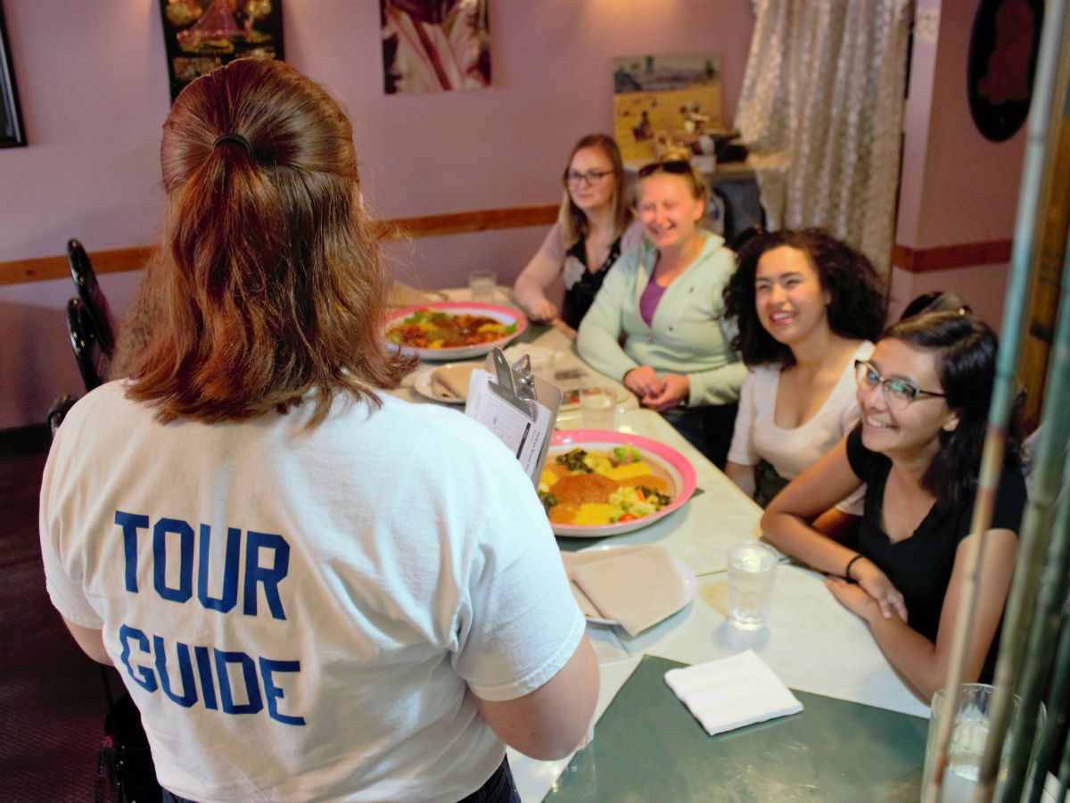Around the world in 14 plates: Why West End Biz Food Tours are a can't-miss culinary experience - A West End Biz guide talking about Harman's on a food tour (PCG)