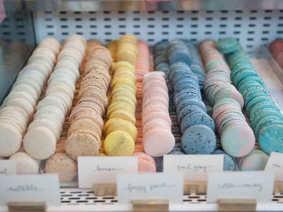 New and notable on Winnipeg's culinary scene for Summer 2018 - The macaron display case at Jenna Rae Cakes' Forks Location is marketing magic (photo courtesy of The Forks)