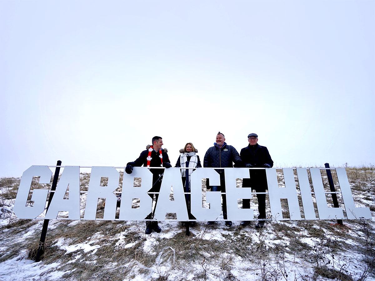 Take that Hollywood: Garbage Hill is here - (L to R) Mayor Brian Bowman, City Councillor Cindy Gilroy, SRS Signs owner Shane Storie and City Councillor Scott Gillingham unveil the new Garbage Hill sign.