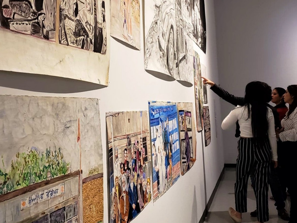 New and notable at the Winnipeg Art Gallery - Visitors checking out the artwork by Jagdeep Raina in the Vision Exchange exhibit. (Photo by Sarah Ferrari)