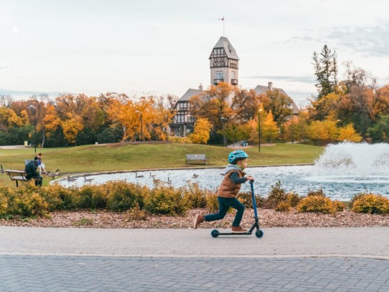 Leaves for your lens: You'll fall for foliage at these Winnipeg spots  - Scooting past the duck pond in autumn at Assiniboine Park (photo courtesy of Roam Creative)