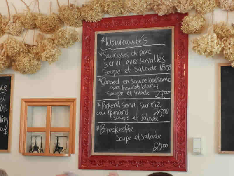Daily specials on chalkboard at Chez Sophie