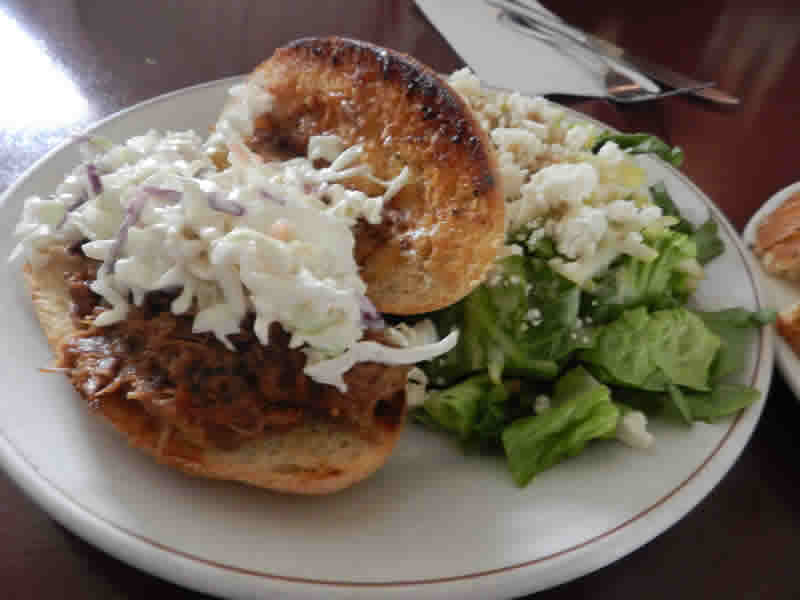 Pulled pork sandwich with pear, feta and walnut salad at Yellow Dog Tavern