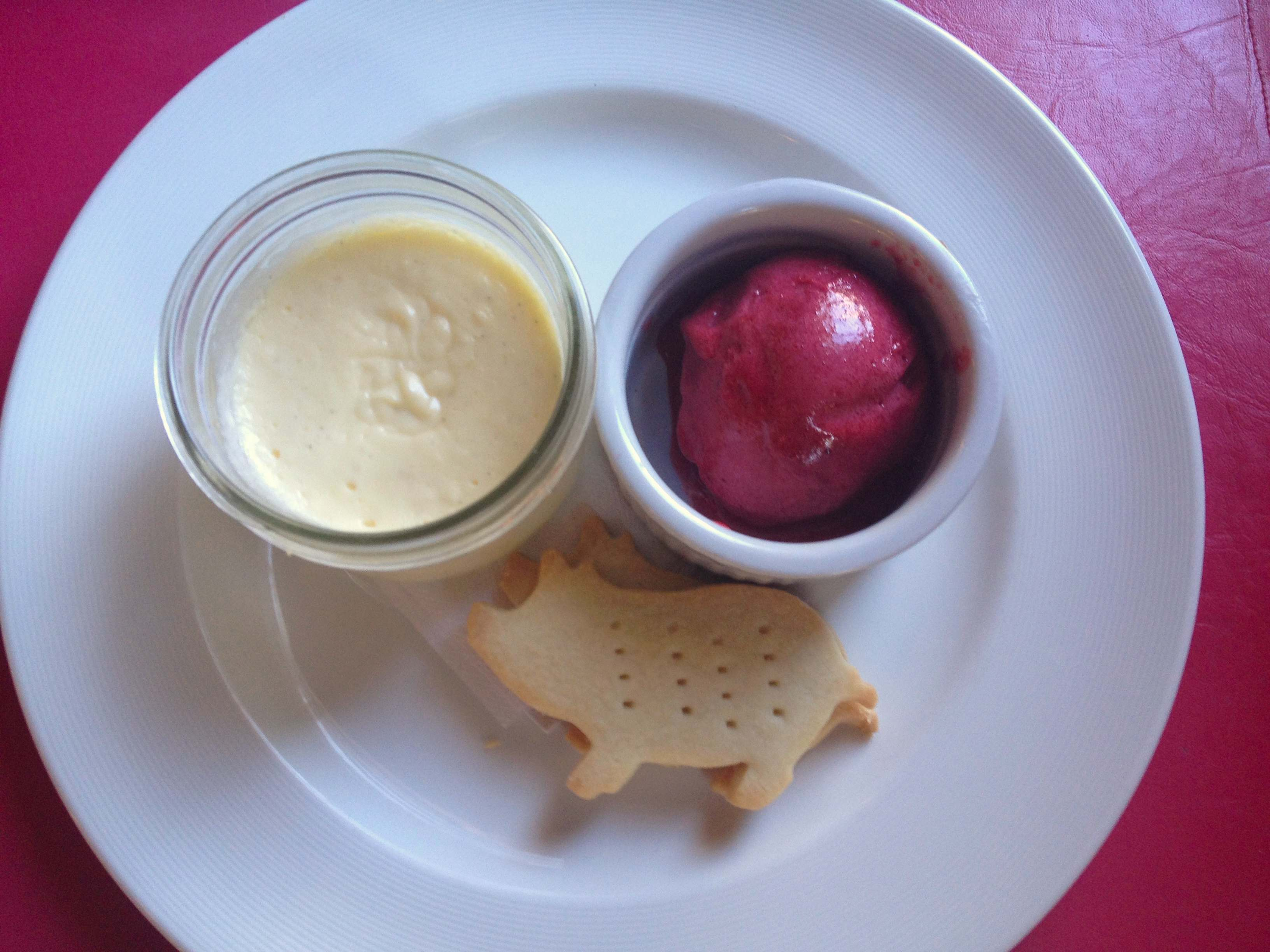Goat cheese cheesecake with sour cherry sorbet and piggie shortbread cookies, Peasant Cookery. (Photo by Robin Summerfield.)