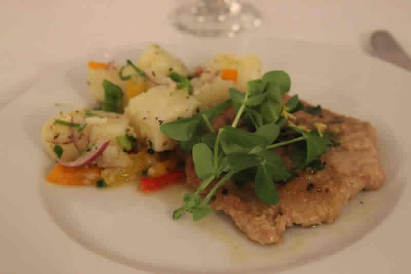 Lemon-baked veal with potato salad at De Luca's. (Photo by Robin Summerfield.)