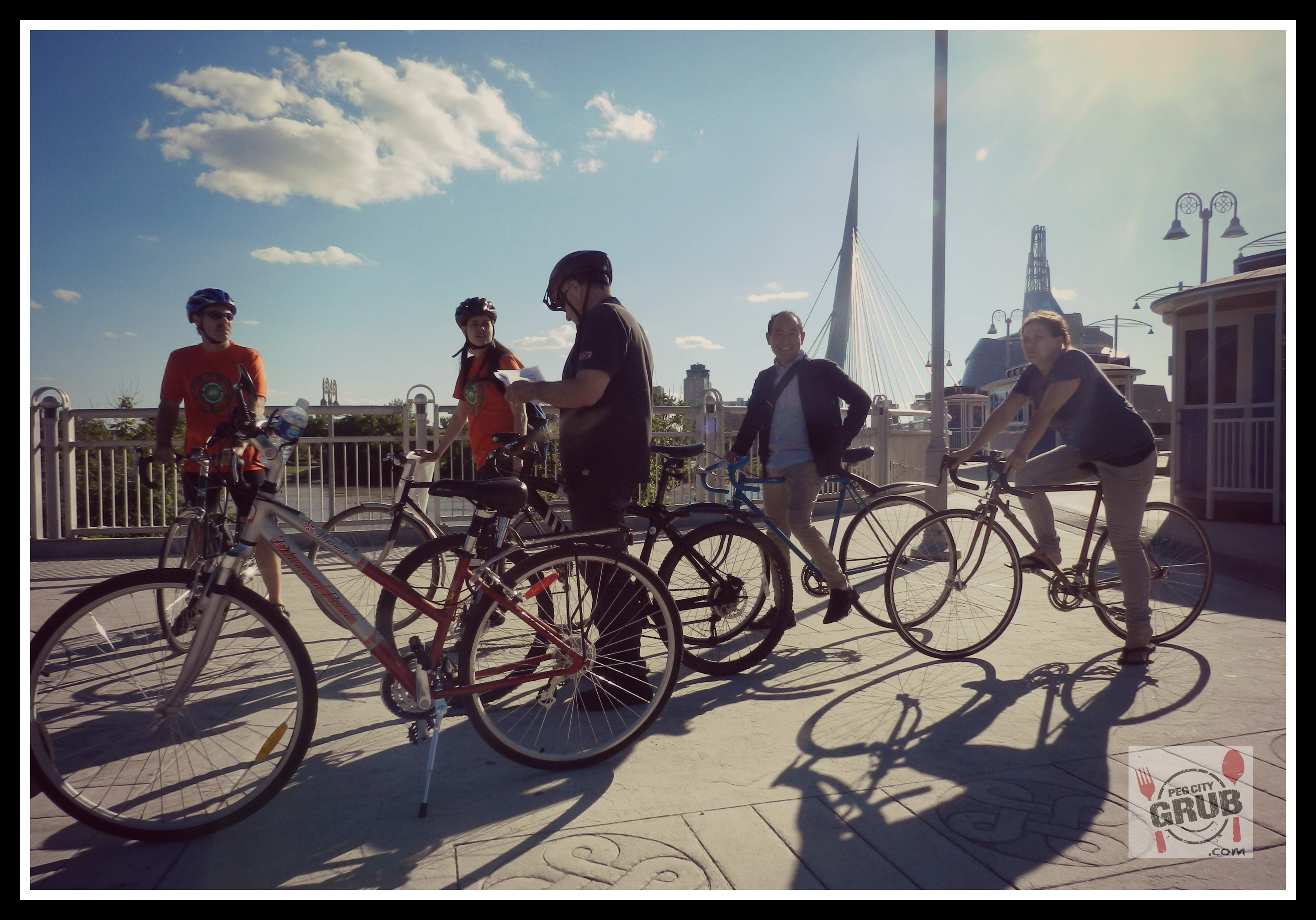 Cyclists take in the sights of downtown Winnipeg at St. Boniface during Moveable Feast 2013. (Photo by Robin Summerfield)
