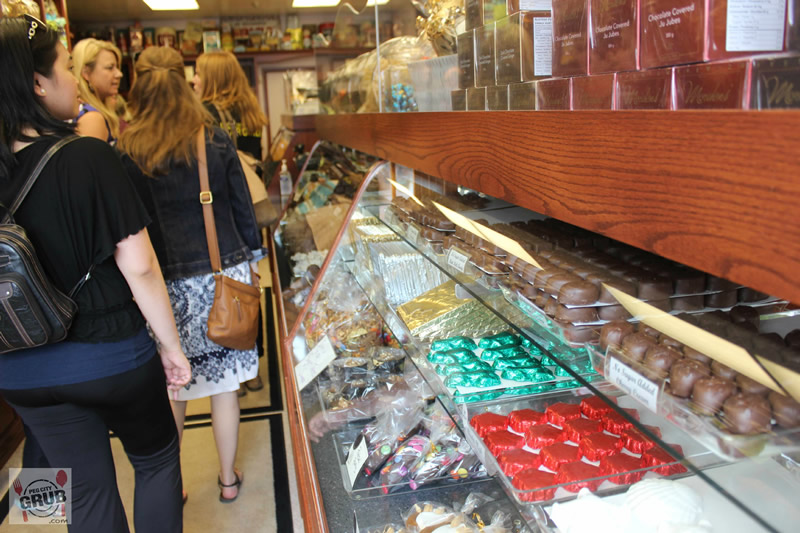 Shoppers peruse the chocolate case inside Mordens' of Winnipeg.