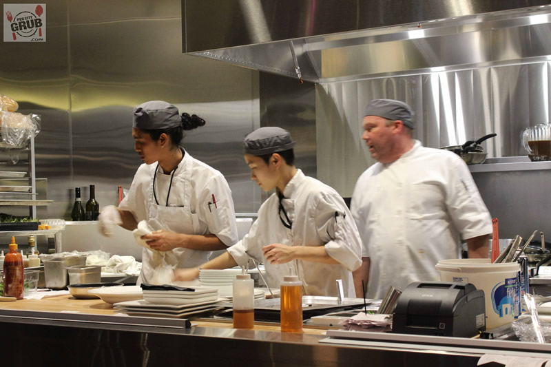 Executive chef Barry Saunders (right) overseeing the troops inside Era's open kitchen.