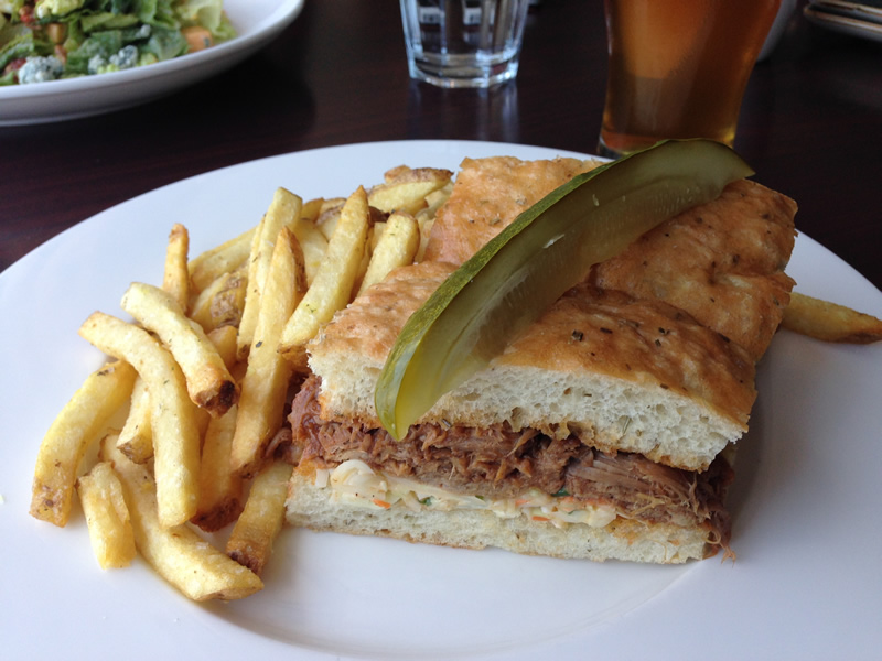 The Pulled Pork & Slaw Sandwich and house cut fries are damn near perfect (PCG)
